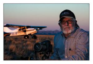 Paul van Schalkwyk with camera in the Namibian bush. Photo and copyright Paul van Schalkwyk Photography
